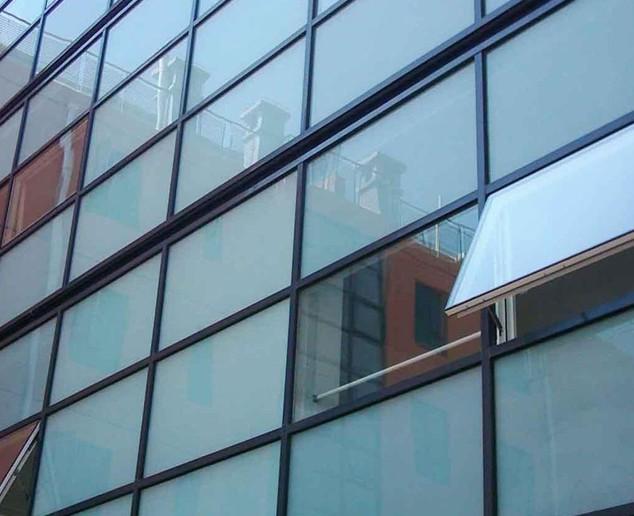 大连干挂石材,花岗岩芝麻灰,干挂玻璃幕墙