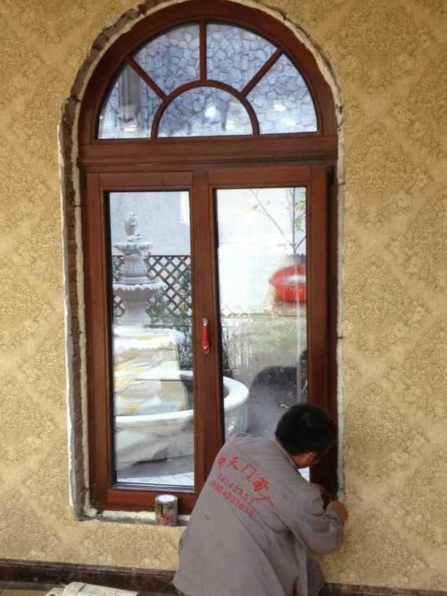 沈阳安装铝包木门窗-中天门窗阳光房